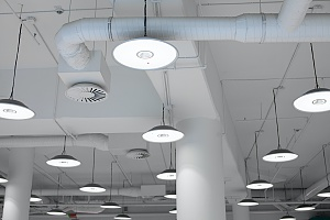 large white water pipes in a commercial building that is protected from legionella in new york city