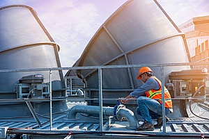 man servicing cooling tower