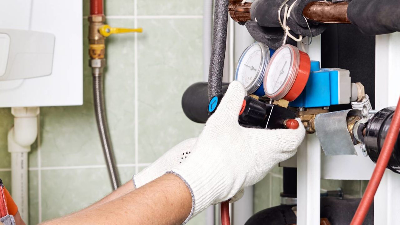 inspector gauges the temperature of the pipes for the companys legionella prevention plan