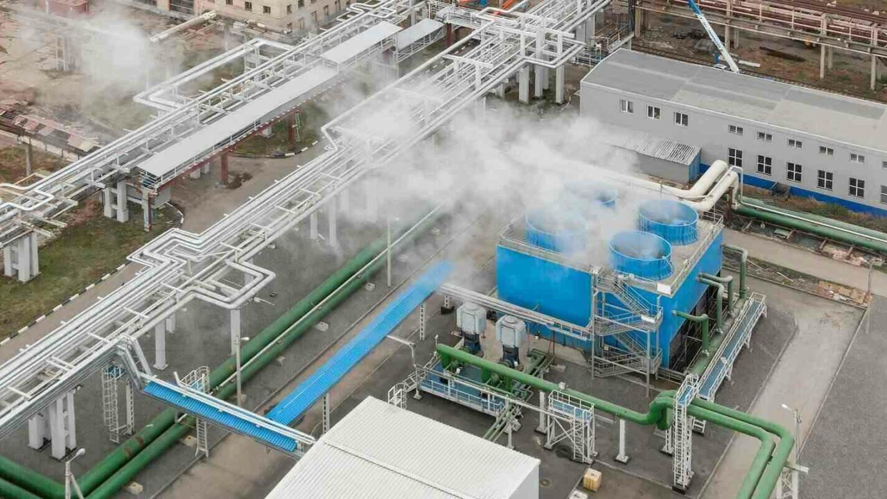 blue industrial cooling tower at a chemical plant