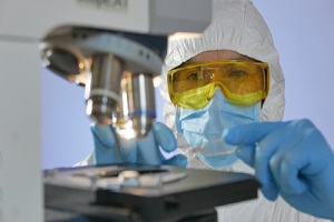 scientist looking at the medical plate through light