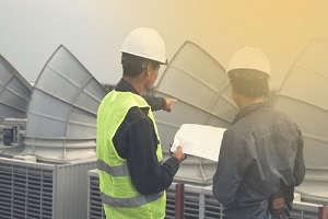 engineers discussing cooling tower design